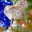 New-year toy a bluebell hangs on a christmas tree — Stock Photo