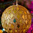 New-year toy a large ball  hangs on a christmas tree - 图库照片