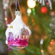 Stock Photo: New-year toy house hangs on christmas tree