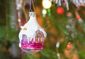 New-year toy a house hangs on a christmas tree — Stock Photo