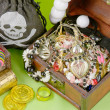 Two small boxes with treasures on a light green background - Стоковая фотография
