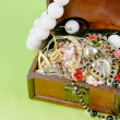 Small box with treasures on light green background — Stok Fotoğraf #18068601