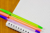 School belonging, notebook and three pens — Stock Photo
