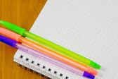 School belonging, notebook and three pens — Stock Photo