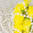 Yellow chrysanthemums and beads are pearls — Stock Photo #18406819