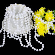 Yellow chrysanthemums and beads are pearls on a black background — Stock Photo #18407297