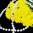 Yellow chrysanthemums and beads are pearls on a black background — Stock Photo #18407323