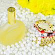Small box, spirits and beads of pearls — Stock Photo #18408743