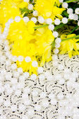 Yellow chrysanthemums and beads are pearls — Stock Photo