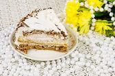 Yellow chrysanthemums, piece of cake and beads — Stockfoto