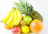 Still life from different fruit on a white background — Stock Photo
