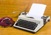 Old typewriter and telephone — Stock Photo