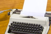 Old typewriter and clean sheet of paper — Stock Photo
