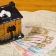 Stock Photo: Toy house and Russimoney on project documentation