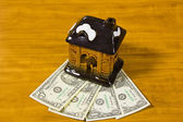 Toy house and dollars — Stock Photo