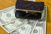 Purse and dollars — Stock Photo