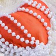 Stock Photo: Red heart and beads from pearls
