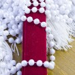 Gift case and beads from pearls — Stock Photo