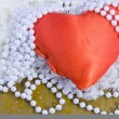 Red heart and beads from pearls — Stock Photo #19206707