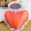 Stock Photo: Cup with tea, cakes and red heart
