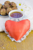Cup with tea, cakes and red heart — Stock Photo