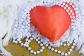 Red heart and beads from pearls — Stock Photo