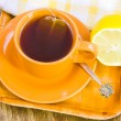 Cup with tea and lemon — Stock Photo