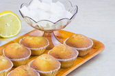 Sweet vanilla domestic cakes, lemon and vase with sugar — Stockfoto