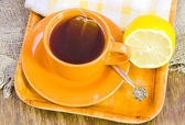 Cup with tea and lemon — Stockfoto