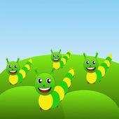 Four amusing caterpillars on a green lawn — Stock Photo
