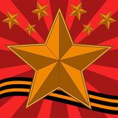 Gold bright stars and yellow-black ribbon — Stock Photo