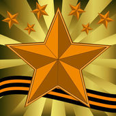 Gold bright stars and yellow-black ribbon — Stock Photo