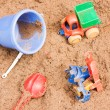 Child's toys lie on sand  — Stock Photo