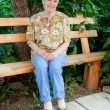 Stock Photo: Elderly womsits on bench