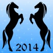 Silhouettes of two horse on a blue background — Stock Photo #32890369