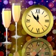 Round clock and two glasses with champagne — Foto Stock #34598613