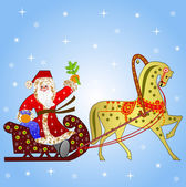 Santa claus with the sack of gifts in sledges in a team with a h — Stok fotoğraf