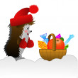 Hedgehog and small basket with gifts on to snow — Stock Photo #34629343