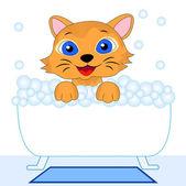 Merry kitten bathes in bath — Stock vektor