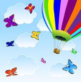 Stor ballong och fjärilar i blå himmel — Stockvektor