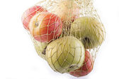 Apples in net — Stock Photo
