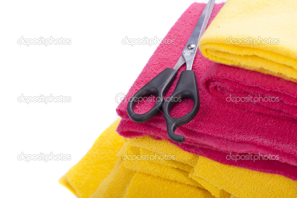 Yellow and red cloths with scissors isolated on a white background — Stock Photo #16970097