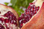 Pomegranat with leafs — Stock Photo