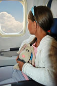Girl on a plane — Stock Photo