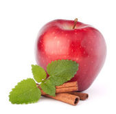 Red apple, cinnamon sticks and mint leaves still life — Stock Photo