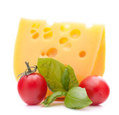 Cheese and basil leaves — Stock Photo