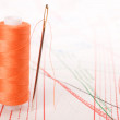 Stock Photo: Spool of thread and needle. Sew accessories.