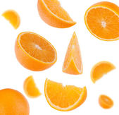 Flying sliced orange fruit segments — Stock Photo