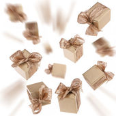 Flying gold gifts background — Stock Photo