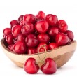 Cherry berries in wooden bowl — Stock Photo